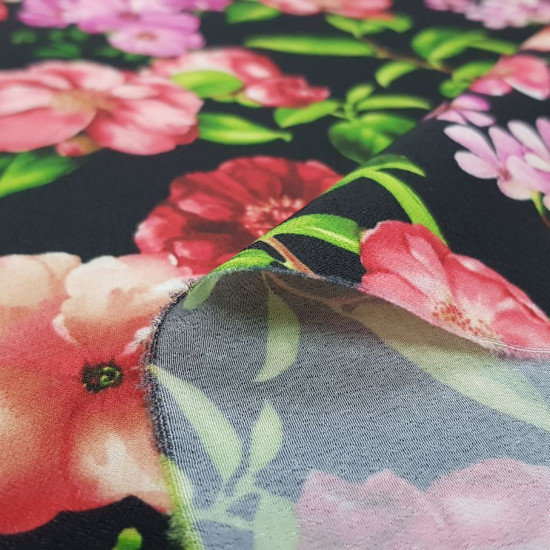 Crepe Flowers Black Background fabric - Koshibo-type crepe fabric with flower drawings on a black background. The fabric is 150cm wide and its composition is 100% polyester.