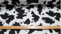 Felt Cow fabric - Felt fabric printed with black pints on a white background, imitating the drawing of the cow's skin. The felt is used a lot in children's crafts, since it is a very easy fabric to handle and cut. It does not fray and can