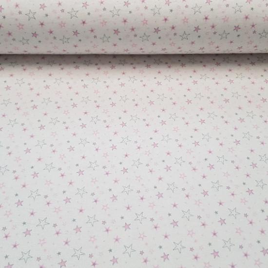 Tela Franela Estrellas - Tela de franela con dibujos de estrellas de colores azúl y rosa sobre fondo blanco. La telade franela es muy calentita para la temporada de frío y se usa mucho en prendas infantiles y complementos. La composición es