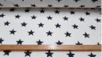 Tela Rizo Toalla Estrellas - Tela de rizo de toalla 100% algodón con dibujos de estrellas en color gris oscurosobre fondo blanco. Tiene un gramaje de 450gr/m2 y el dibujo está solo por una cara. La tela mide 150cm de ancho y su composición 100%