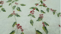 Tablecloths Christmas Jacquard Holly fabric - Beautiful Christmas-themed jacquard tablecloth fabric with holly drawings in the center, making a table runner, with floral patterns in relief and on the back of the fabric. The fabric is 150cm wide and its co