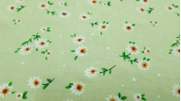 Fine Cotton Daisies Green fabric - Fine cotton bed sheet-like fabric with drawings of white daisy flowers on a light green background. The fabric is 150cm wide and its composition is 100% cotton.
