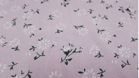 Fine Cotton Flowers Pink fabric - Fine cotton bed sheet-like fabric with dandelion-like flower patterns on a light pink background. The fabric is 150cm wide and its composition is 100% cotton.