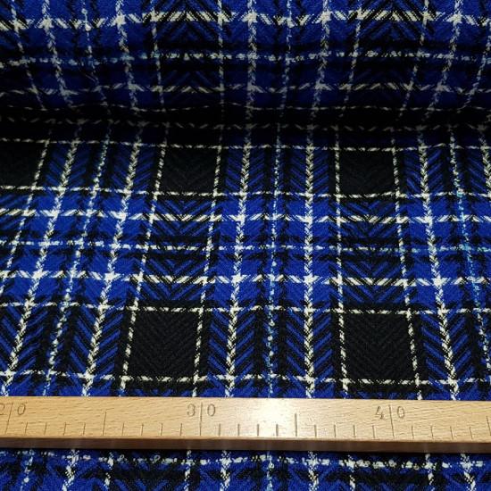 Tela Lana Cuadro Tartán - Tela de lana mezcla con poliester con dibujo tartán en color azul, negro y blanco. Se puede apreciar forma de espiga en los trazos de color negro. La tela mide 150cm de ancho y su composición lana y poliester.