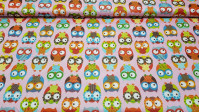 Cotton Colorful Owls fabric - Very colorful cotton fabric with drawings of owls of many varied colors and textures on a pink background. The owls have huge eyes very bright and funny.