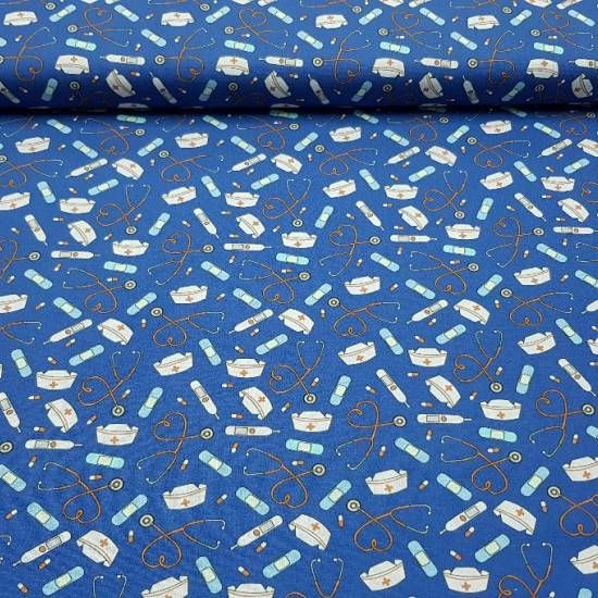 Cotton Medical Clinic fabric - Hospital-themed cotton fabric with drawings of thermometers, pills, strips ... on a blue background.