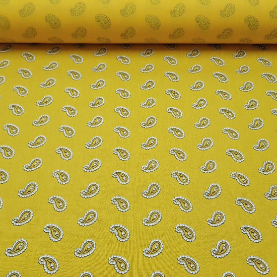 Cotton Yellow Cashmere fabric - Cotton fabric with cashmere style drawings on a yellow background. The fabric is 150cm wide and its composition 100% cotton.