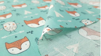Cotton Owls and Foxes fabric - Kids cotton fabric themed tipi tents, with drawings of foxes, owls, arrows, triangles and teepee tents, on a sea green background.