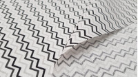 Cotton Gray Zigzag fabric - Cotton fabric with striped patterns zigzag in gray and black colors on a white background. The fabric is 150cm wide and its composition 100% cotton.