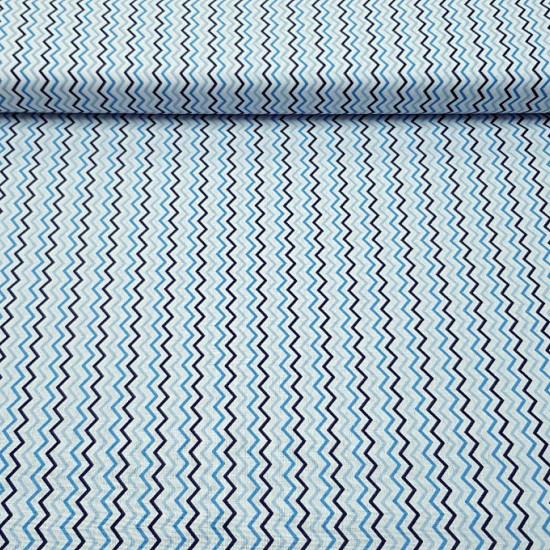 Tela Algodón Zig-zag - Tela de algodón con dibujos de rayas haciendo zig-zag en colores de tonos azulessobre un fondo blanco. La tela mide 150cm de ancho y su composición 100% algodón.