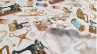 Cotton Vintage Sewing fabric - Satin cotton fabric with vintage drawings on a sewing theme, with sewing machines, scissors, needles, threads, irons... on a white background. The fabric is 140cm wide and its composition is 100% cotton.
