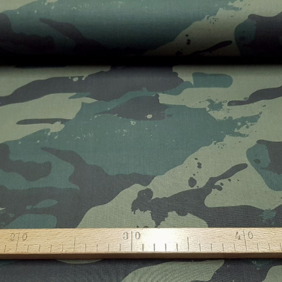Cotton Camouflage Large Green fabric - Cotton fabricdigital printing with camouflage pattern in large weft where green color predominates. The fabric is 140cm wide and its composition is 100% cotton