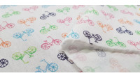 Cotton Bicycles Colors fabric - Children's cotton fabric with drawings of colored bicycles on a white background. The fabric is 150cm wide and its composition is 100% cotton.
