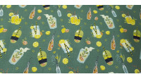 Cotton Cocktails Mojito fabric - Organic cotton fabric with drawings of cocktails, juices, mojitos... on a green background with acidic fruits. The fabric is 150cm wide and its composition is 100% cotton.