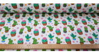 Cotton Kawaii Cactus fabric - Digital printed cotton fabric with beautiful Kawaii style cactus drawings on a white background with flowers. Exclusive TextilSiles fabric. The fabric is 140cm wide and its composition is 100% cotton.