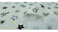 Cotton Neon Stars Yellow fabric - Cotton fabric with drawings of different stars in black and smaller ones in neon yellow on a white background. The fabric is 150cm wide and its composition is 100% cotton.