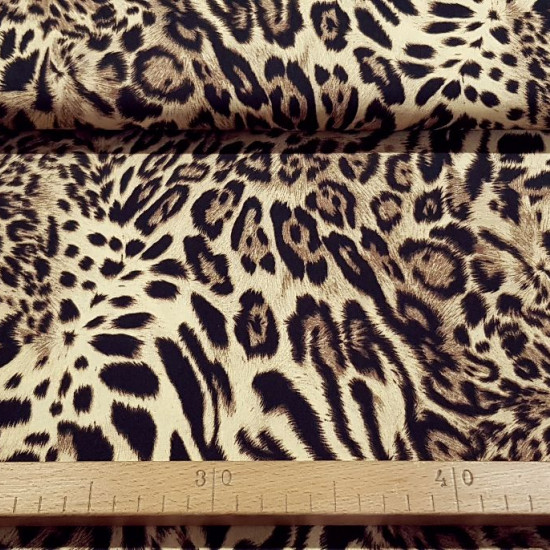Cotton Animal Print Cinnamon fabric - Cotton fabric with animal print pattern in brown tones. The fabric is 140cm wide and its composition is 100% cotton.