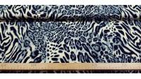 Tela Algodón Animal Print Crema - Tela de algodón con estampado animal print en tonos crema y gris. La tela mide 140cm de ancho y su composición 100% algodón.