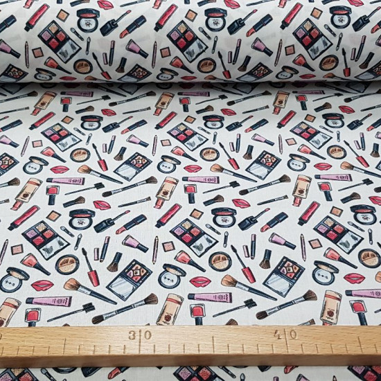 Cotton Makeup fabric - Cotton fabric with drawings of makeup utensils and accessories on white background. The fabric is 140cm wide and its composition is 100% cotton.
