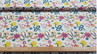 Cotton Tropical Snakes fabric - Organic cotton fabric (GOTS) with drawings of snakes and colorful tropical vegetation on a white background. The fabric is 150cm wide and its composition is 100% cotton.