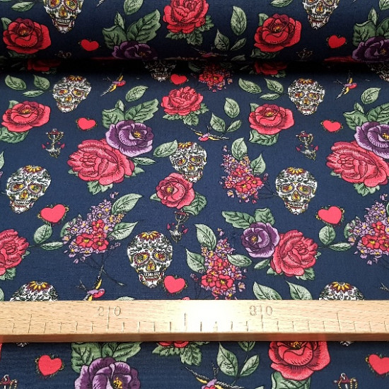 Cotton Roses and Skulls fabric - Very original cotton fabric with drawings of roses and skulls in multicolor on a dark blue background. This fabric is ideal for making any type of accessory and garment. The width of the fabric is 150cm and its compo