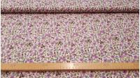 Tela Algodón Flores Mimosa - Tejido Patchwork 100% Algodón con flores lilas sobre fondo rosa claro. La tela mide 150cm de ancho.