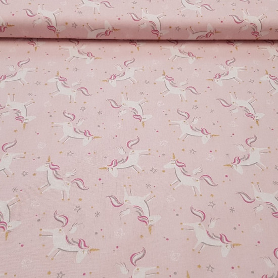 Cotton Unicorns fabric - A cotton fabric in which unicorns, stars and dots appear on a pink background.