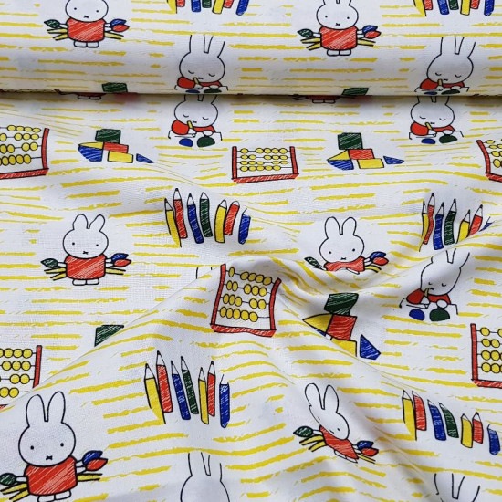 Cotton Miffy Learning fabric - Licensed cotton fabric with drawings of the character Miffy painting with pencils and learning geometric shapes. This fabric is part of the Miffy At School collection by Craft Cotton Company. The fabric is 110cm