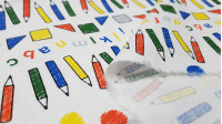 Cotton Miffy Drawing fabric - Licensed cotton fabric with drawings of colored pencils, geometric shapes and colored letters on a gray background. This fabric is part of the Miffy At Scholl collection of The Craft Cotton Company. The fabric is