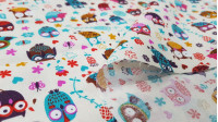 Cotton Owls Colors White fabric - Cotton fabric with drawings of owls in many colors on a cream white background with flowers. This fabric is part of The Craft Cotton Company's Happy Owls collection. The fabric is 110cm wide and its compositi
