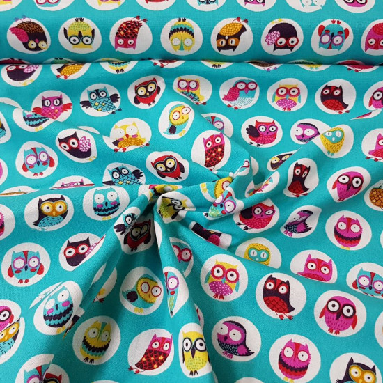 Cotton Owls Colors Turquoise fabric - Cotton fabric with drawings of owls in white circles on a turquoise background. This fabric is part of The Craft Cotton Company's Happy Owls collection. The fabric is 110cm wide and its composition is 100% co