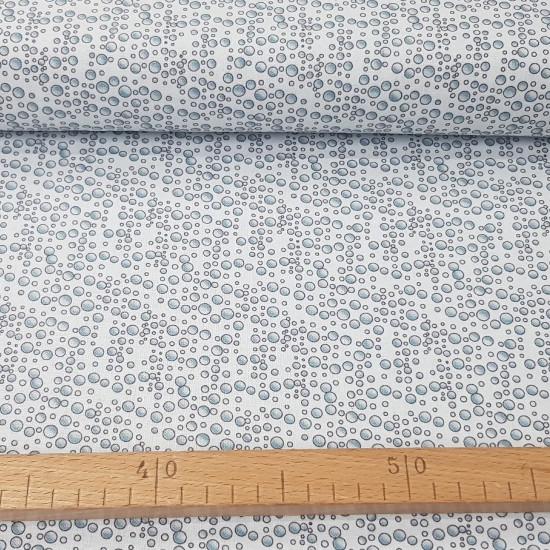 Tela Algodón Burbujas del Mar - Tela de algodón ancho americano con dibujos de burbujas sobre un fondo blanco. La tela mide 110cm de ancho y su composición 100% algodón.