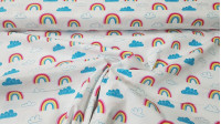 Cotton Rainbow Clouds fabric - Cotton fabric with drawings of rainbows and clouds in blue tones on a white background. The fabric is 110cm wide and its composition is 100% cotton.