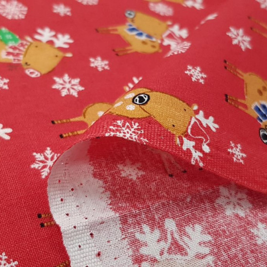 Tela Algodón Navidad Renos Rojo - Tela de algodón navidad ancho americano con dibujos de renos sobre un fondo de color rojo con copos de nieve. La tela mide 110cm de ancho y su composición 100% algodón.