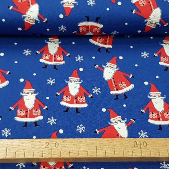 Tela Algodón Navidad Noel Azul - Tela de algodón navidad ancho americano con dibujos de papá noel sobre un fondo azul con copos de nieve. La tela mide 110cm de ancho y su composición 100% algodón.