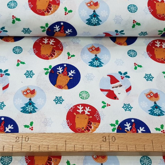 Cotton Christmas Noel Spheres fabric - Christmas cotton fabric with drawings of colored spheres where reindeer, Santa Claus, owls... appear on a white background decorated with holly trees and snowflakes. The fabric is 110cm wide and its composition is 10