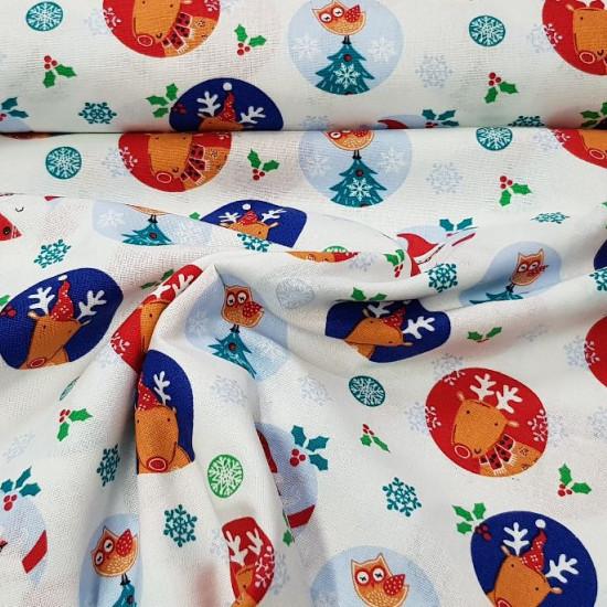 Tela Algodón Navidad Noel Esferas - Tela de algodón navidad ancho americano con dibujos de esferas de coloresdonde aparecen renos, papá noel, búhos…sobre un fondo blanco decorado con acebos y copos de nieve. La tela mide 110cm de ancho y su composici