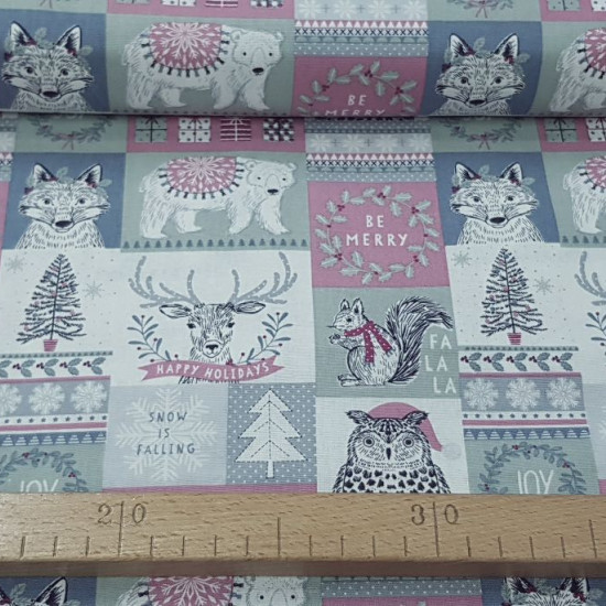 Cotton Christmas Forest Mosaic fabric - Christmas cotton fabric with drawings forming a mosaic of animals and Christmas borders. The fabric is 110cm wide and its composition is 100% cotton.