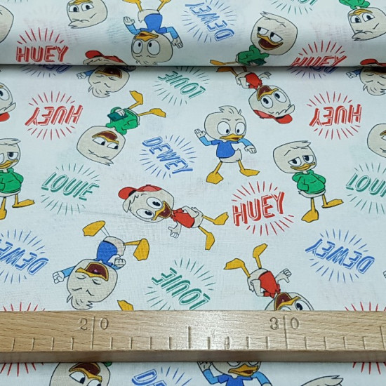 Cotton Disney DuckTales fabric - Very funny cotton fabric with Disney theme, with the characters from the Duck Adventures series (DuckTales) on a white background.