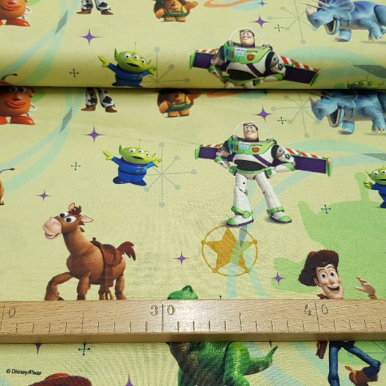 Cotton Disney Toy Story Yellow fabric - Disney children's cotton fabric by Toy Story. The characters Woody, Buzz, Mr. Potato appear ... on a background where light yellow and green colors predominate. The fabric is 150cm wide and its composition 100% cott