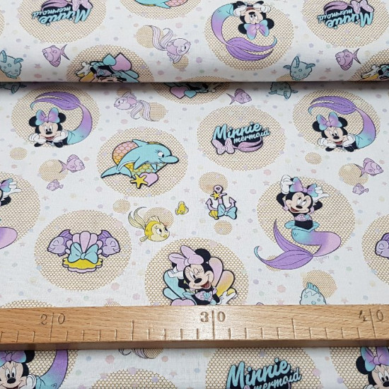 Disney Cotton Minnie Mermaid fabric - Children's themed cotton fabric with the Disney character Minnie the little mermaid and drawings of fish and anchors, all with lots of color!