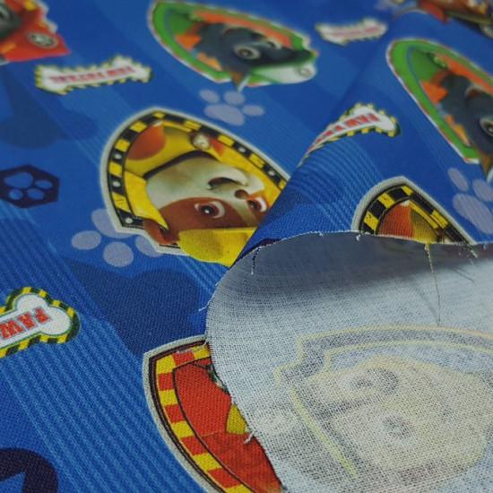 Tela Algodón Patrulla Canina - Tela de algodón infantil de licencia con los personajes de la Patrulla Canina sobre un fondo azul.