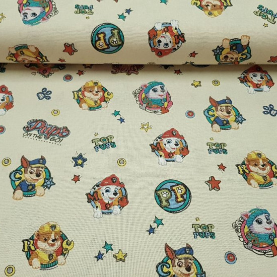 Paw Patrol Cotton Light Yellow fabric - Children's cotton fabric with the characters of the Paw Patrol on a light yellow background. The fabric is 140cm wide and its composition 100% cotton