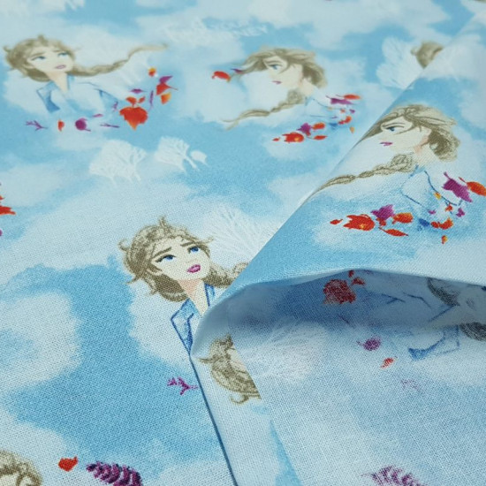 Cotton Disney Frozen 2 Elsa fabric - Disney digital cotton fabric with the character Elsa from the movie Frozen 2 on a light blue background with white trees and clouds. The fabric is 110cm wide and its composition 100% cotton.