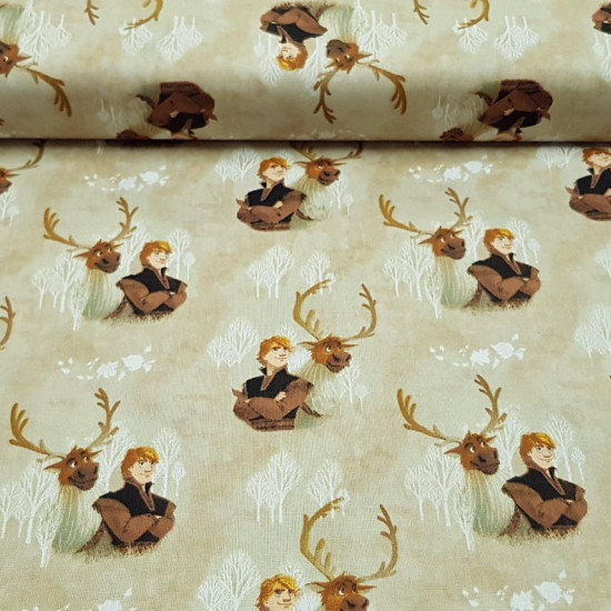 Cotton Disney Frozen 2 Kristoff and Sven fabric - Disney digital cotton fabric with the characters Kristoff and Sven from the movie Frozen 2 on a sand-colored background with white trees. The fabric is 110cm wide and its composition 100% cotton.