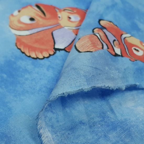 Cotton Disney Finding Nemo Blue fabric - Children's cotton fabric with the character Nemo and Marlin, from the Disney Pixar movie FindingNemo on a blue background. The fabric is 160cm wide and its composition 100% cotton.