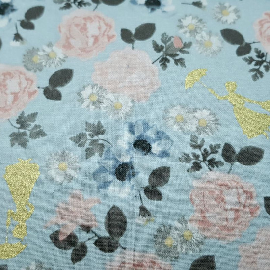 Cotton Disney Mary Poppins Flowers fabric - Disney cotton poplin fabric in American width with drawings of silhouettes of Mary Poppins in bright golden color on a blue background with flowers and colorful roses. The fabric is 110cm wide and its compositio