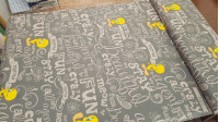 Cotton Looney Tunes Tweety fabric - Cotton fabric with large design of Warner Bros licensed drawings of the Tweety character of the Looney Tunes, which appears in various poses on a background of gray letters. Ideal fabric for all kinds of decoration, mak