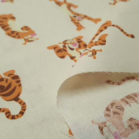 DIsney Tigger Cotton Yellow fabric - Disney licensed cotton fabric with drawings of the character Tigger from the endearing movie and series Winnie the Pooh, on a light yellow background. The fabric is 140cm wide and its composition is 100% cotton.