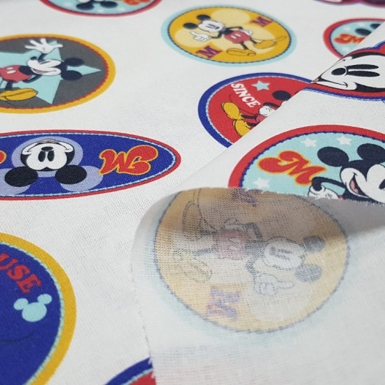 Cotton Disney Mickey Patches fabric - Disney licensed cotton fabric with drawings of the character Mickey in round and oval shaped patches on a white background. The fabric is 150cm wide and its composition is 100% cotton.